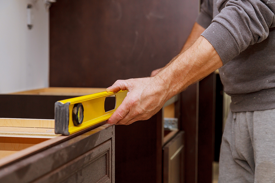 Remodeling your house can be a fun project. You get to update appliances, change paint colors and overall redefine your home the way you want it. Moving things around yourself is fine, but you'll want to leave the more complicated remodeling to the professionals. For instance, if wiring is involved it can become a safety hazard if dealt with improperly. If you are planning a full remodel and gutting your home to start with a blank slate, you should really seek out a professional remodeling contractor. Saws, drills and other hefty equipment will be in use and your home will become a hazard zone professionals are trained for. Professionals also come with a team to get the job done quickly. You don't want to spend weeks spitting sawdust while your bathroom is under construction, DIY-style. Bring in contractors who can tackle a remodel project in no time. For the best Hesperia, CA residential remodeling contractors, Landry's Painting is your number one choice. We offer multiple services to take your remodel project from studs to final paint coat, and everything in between. More Than Just Paint Landry's Painting offers several services and skill profiles to make your remodeling process as smooth as possible. Along with painting we also offer stucco repair, drywall repair, wallpaper removal, wood restoration, antiquing, epoxy coating and much more related to updates. We also fix problems that can get your remodel off to the right start, including addressing fire and water damage repair, acoustic ceiling tile removal and cabinet refinishing. With our skills and decades of experience, we get your home remodeled to the professional level you desire. Remodeling for Style One of the biggest reasons that people choose to remodel is style. Trends change. If you're purchasing a home more than twenty years old, there are likely a few things you'd like to change in it. In recent years, swapping gold and frosted glass bathroom fixtures for higher quality glass showers and vessel sin